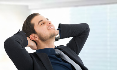 Relaxed businessman with closed eyes
