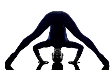 woman exercising Prasarita Padottanasana Wide Legged Forward Ben