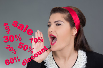 sale concept - beautiful pinup girl screaming over grey