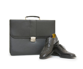 Shoes and bag on white background