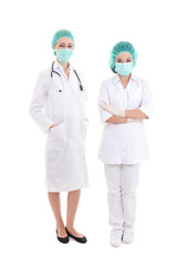 two full length young women doctor in surgical mask and cap isol