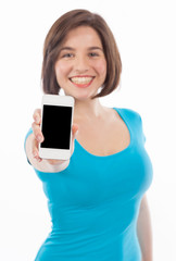 Pretty brunette presenting a smartphone (focus on the phone)