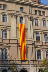 building outdoors in Barcelona street with big catalan flag