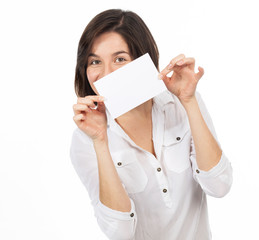 Pretty young woman showing a blank business card