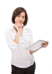 Woman holding an electronic tablet and looking doubtful