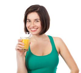 Cute smiling brunette drinking an orange juice