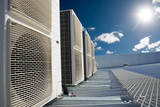 Air conditioner units with sun and blue sky