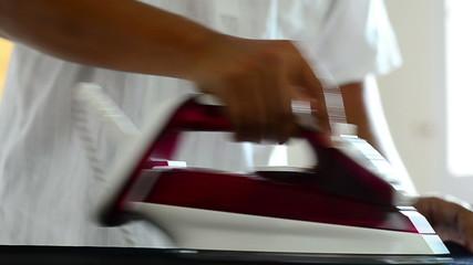 man ironing at home
