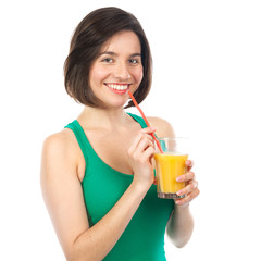Pretty brunette and orange juice