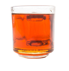 Honey in glass jar over white background