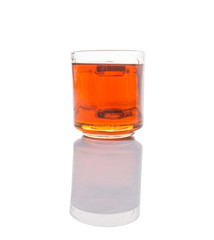Honey in glass jar over white background
