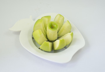 A green apple in a fruit-divider