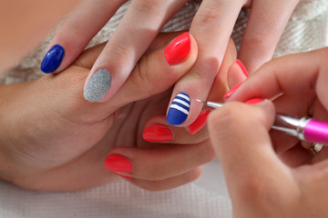 Beauty treatment of fingernails painting with brush and lacquer