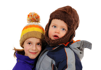 Cute children dressed in winter clothes