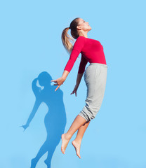Modern style woman dancer performing and  jumping up