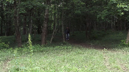 man is walking from the forest