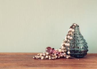 vintage antigue perfume bottle, on woode