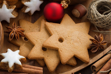 Assorted Christmas cookies, decorations and spices, close-up