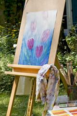 Künstler Staffelei im Garten mit Bild