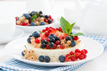 mini cheesecake with fresh berries, horizontal