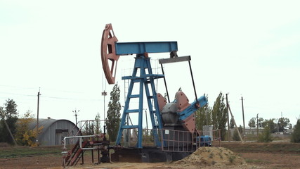 Work of oil pump jack on a oil field.