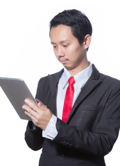 Portrait of young business man using tablet, isolated over white