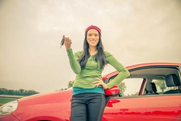 Asian woman showing car keys