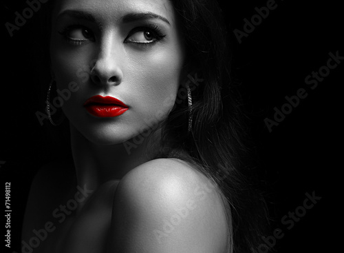 canvas print picture Beautiful mysterious woman in darkness looking dramatic