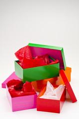 Four open gift boxes.