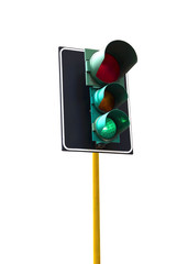 Traffic light isolated on white background is lit green