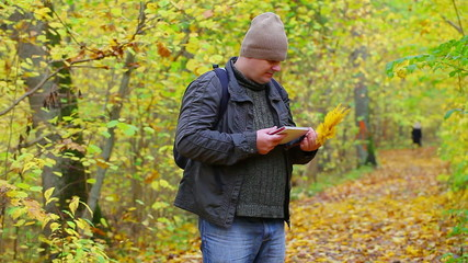 Hiker looking for information in tablet PC
