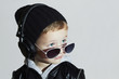 little DJ.boy in sunglasses and headphones.child listening music