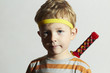 funny child play ninja.Little Boy with ninja sword.Masquerade