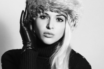Monochrome portrait.Young Woman in Fur Hat.Black Leather Gloves