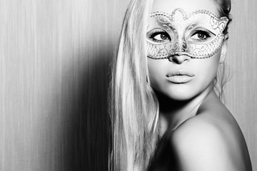 Beautiful Blond Woman in Carnival Mask.monochrome portrait