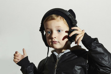 funny child enjoy music. Little boy in headphones