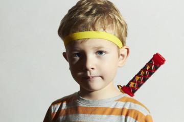 funny child play ninja.Little Boy with ninja sword.Masquerade