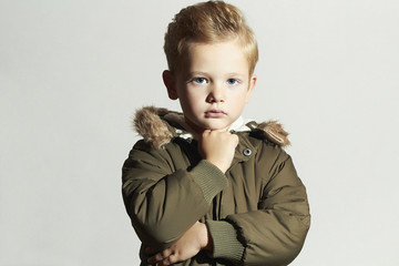 child in winter coat. fashion kids.little boy hairstyle