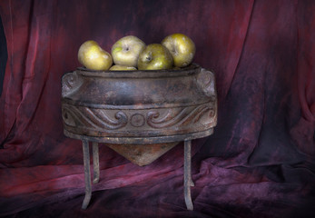 Classical still life with apples and old amphora.