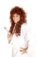 woman red hair white jacket shot needle smile