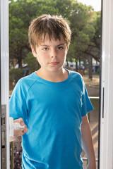 child opening a door