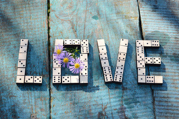 word love of wooden dominoes