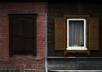 The old shabby wood closed and opened windows with shutters