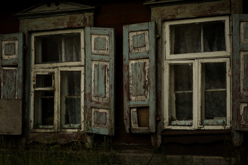 The old shabby wood opened window with shutters