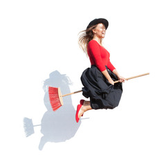 Happy young witch flying on a broom, halloween concept