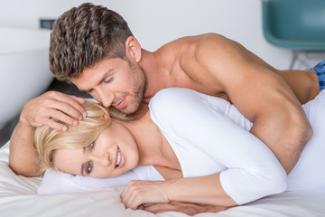 Romantic Partners Lying on Bed Fashion Shoot