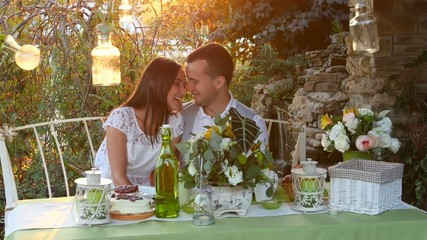 Man and woman kissing at the holiday table