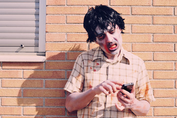scary zombie using a smartphone