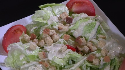 Caesar salad in exhibitor at a restaurant