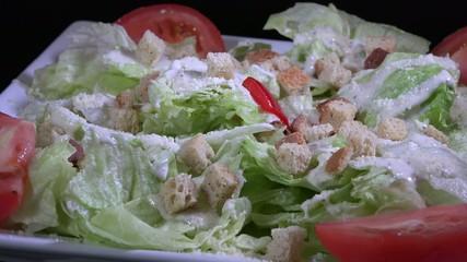 Caesar salad in exhibitor at a restaurant